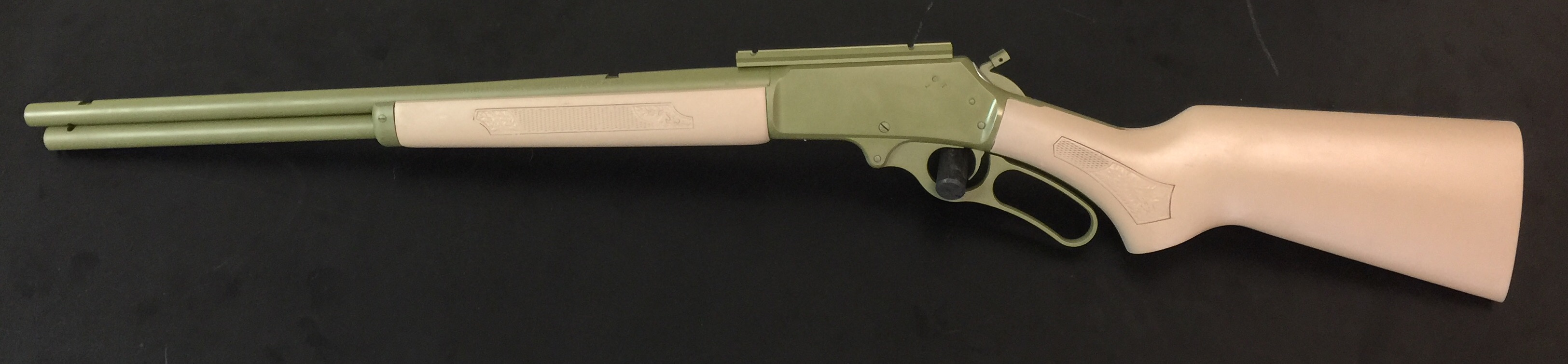 Cerakote on a wood stock in Coyote tan and bazooka green