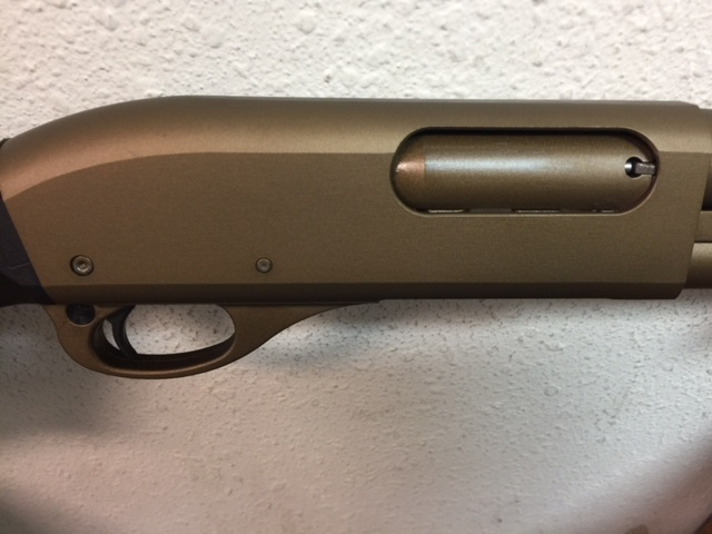 Action of a shotgun done in burnt bronze