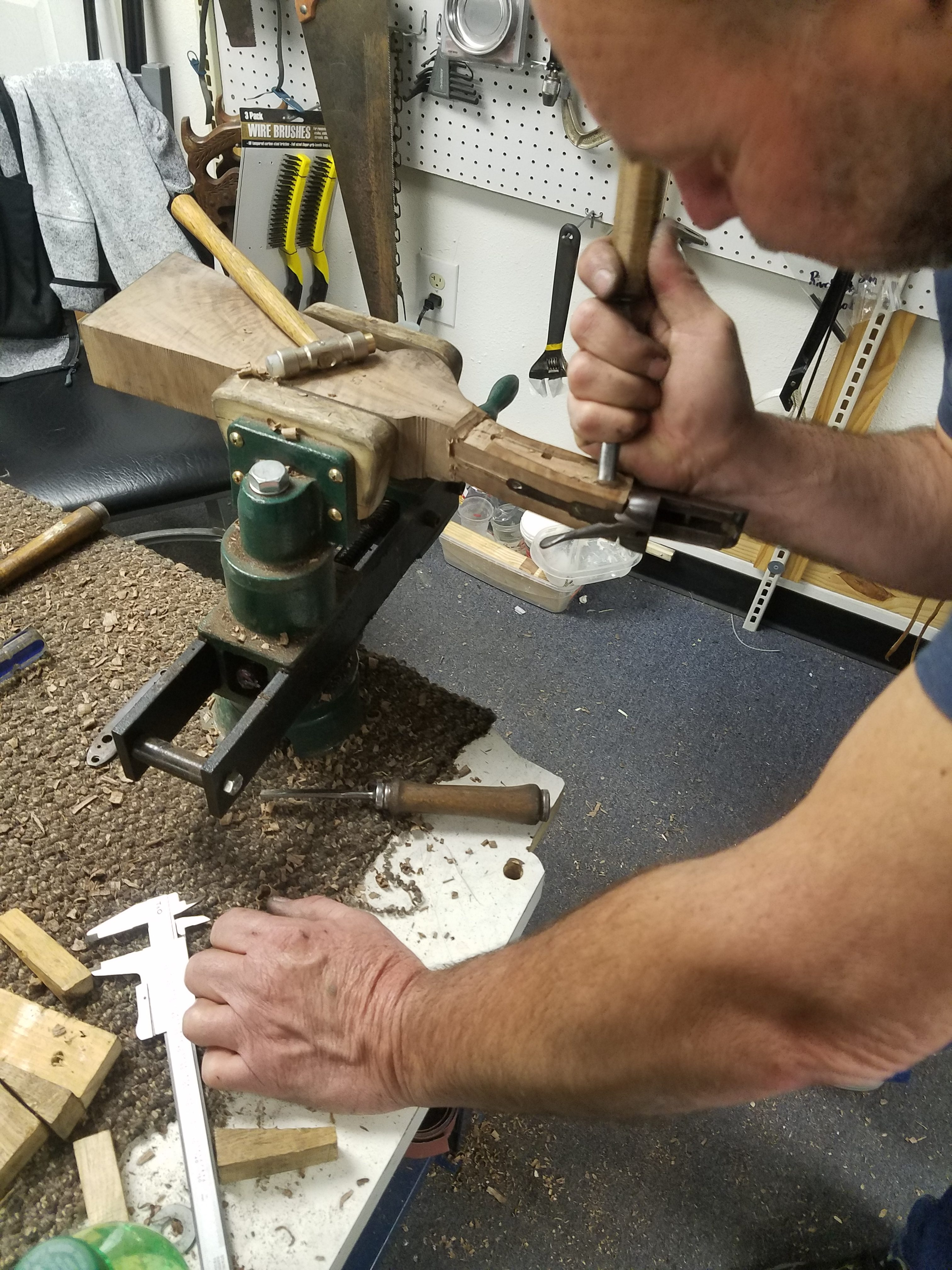 shaping and in letting for the side plate of a shot gun