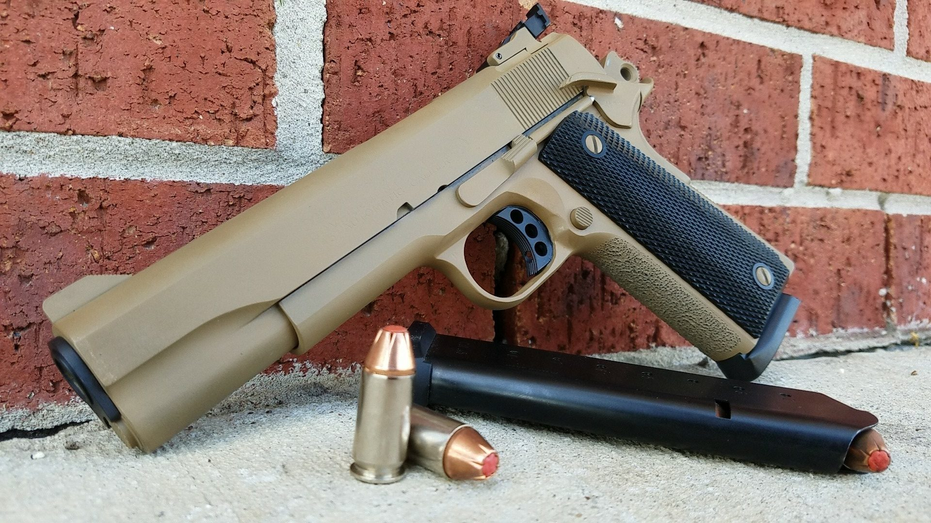 Colt Mark IV in .45 acp cerakoted in troy coyote tan