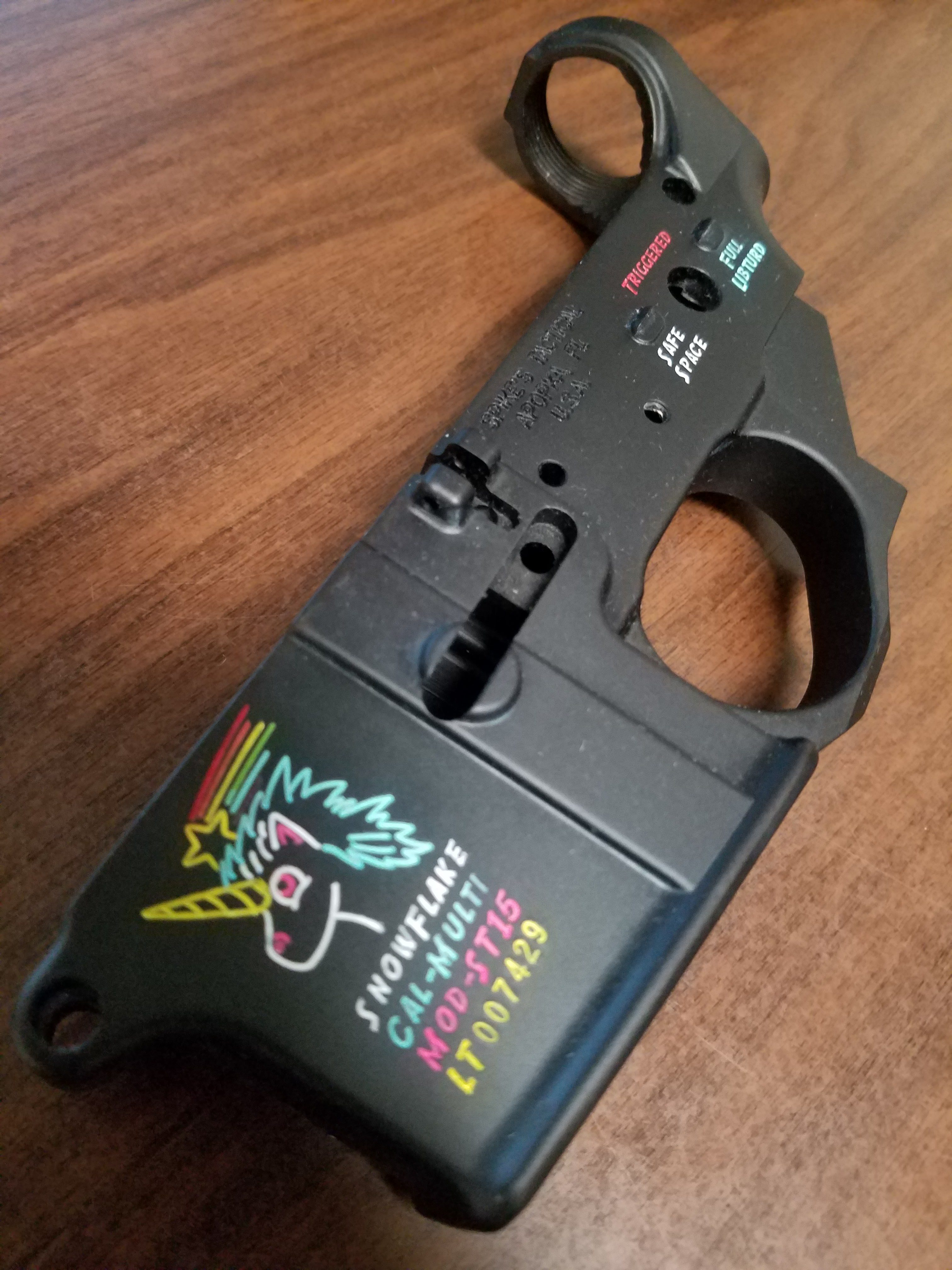 Color filled in the words on the Spikes Tactical snow flake lower