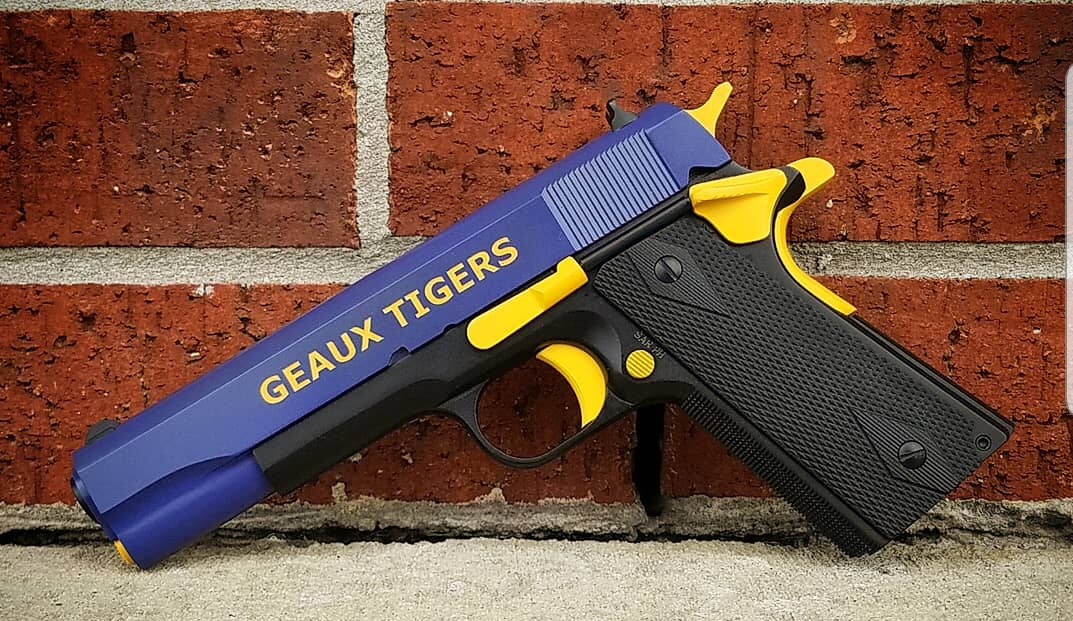 Firearms coated in a LSU theme