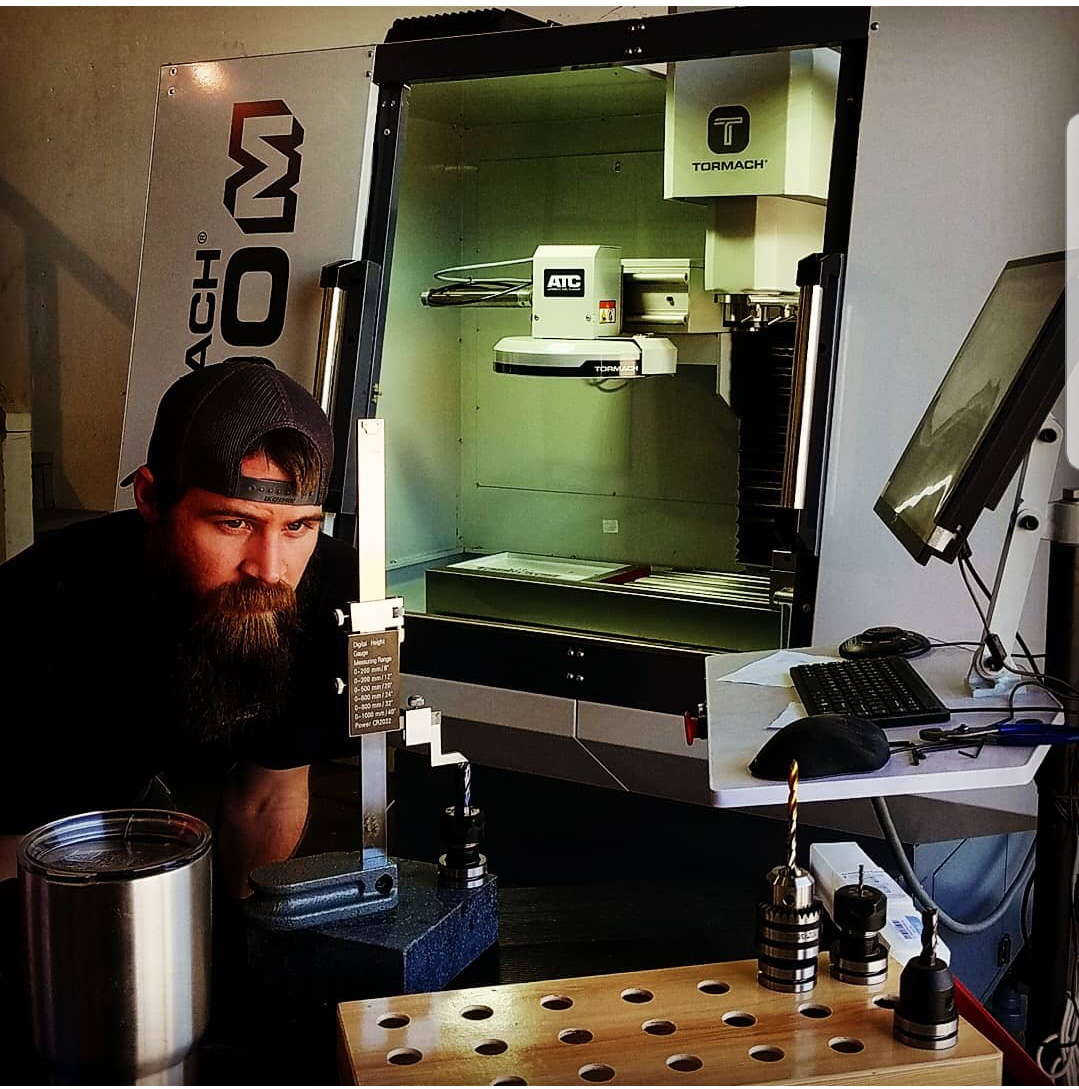 Levi making custom parts on our Tormach 1100M CNC